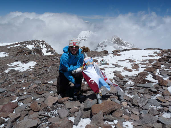 Gerrit Vrugdenhil on the summit of Aconcagua with the pocket Guidebook