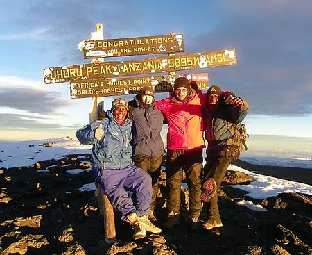 Micha & Jaffa Feiberg at the summit of Kilimanjaro, 7summits.com expeditions