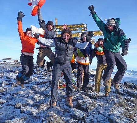 Cameron Bass and friends on the summit of Kilimanjaro, 7summits.com Expeditions