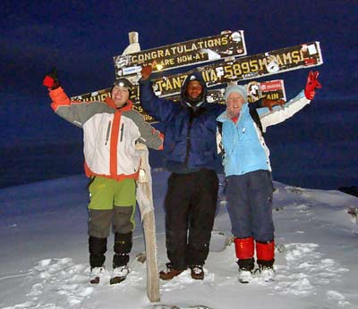 Barbara McElvaney on the summit of Kilimanjaro, Tanzania, on 7summits.com Expeditions
