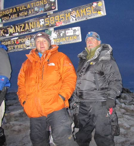 Marc Whittier on the summit of Kilimanjaro, 7summits.com Expeditions
