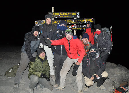 Tom Stuivenberg and group on the summit of Kilimanjaro, 7summits.com Expeditions