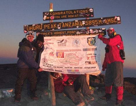 Ovidiu japan Cismas on teh summit of Kilimanjaro, 7summits.com Expeditions