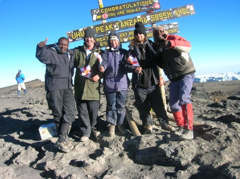 Alan Kelsey Guerin on the summit of Kilimanjaro, 7summits.com Expeditions